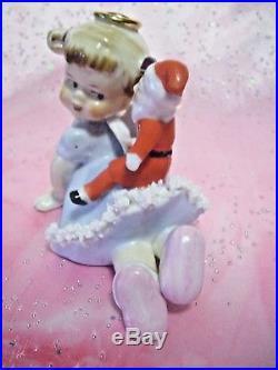 RARE VTG Japan Christmas Blue Angel Girl w Santa Doll on Back Figurine