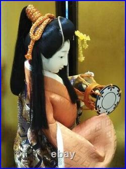 Vintage Japanese Geisha doll in Kimono 23 on wooden base Antique Orange Gold